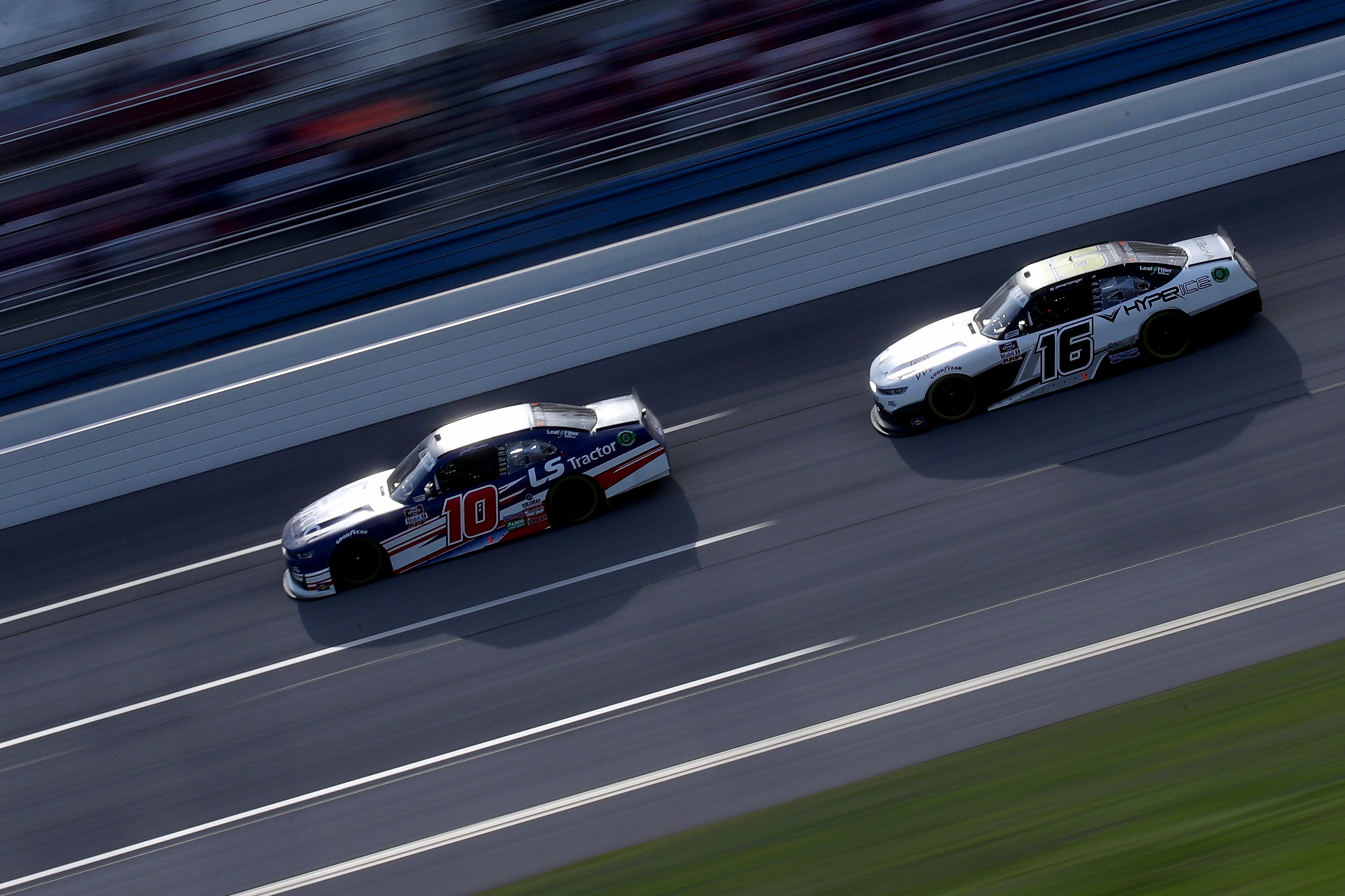 jeb burton leads to victory cars on track